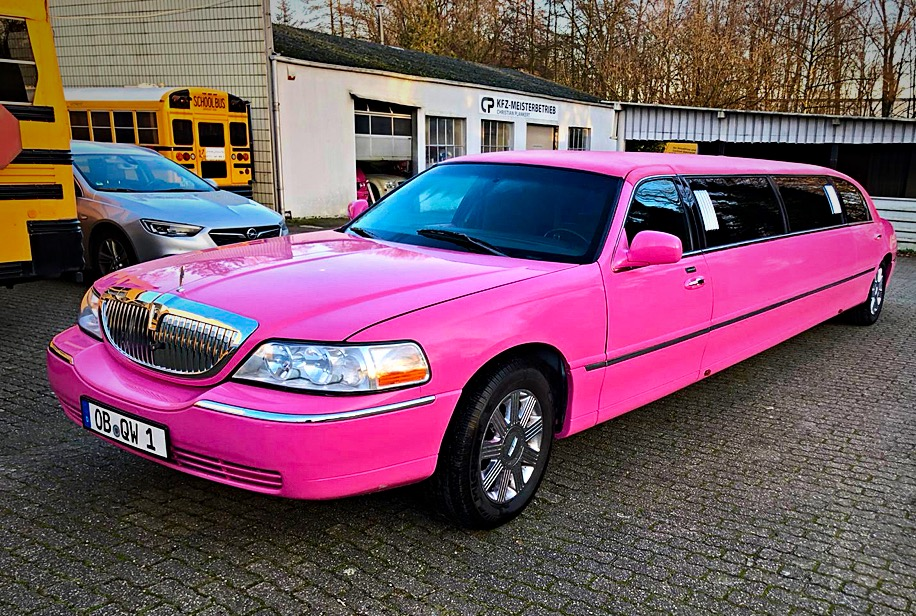 Pink Lincoln Town Car Limousine